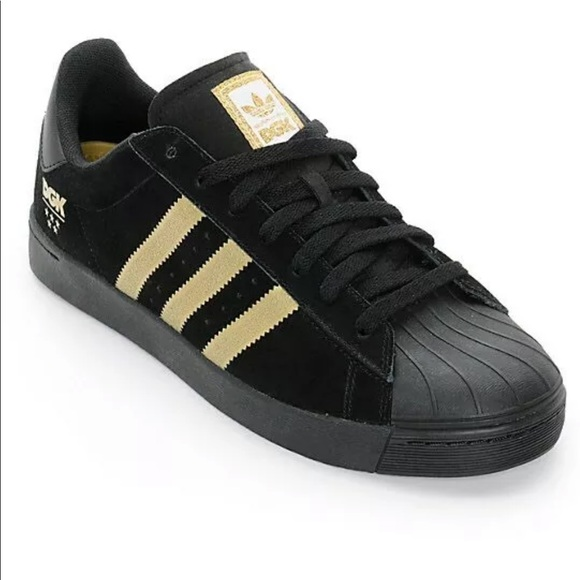 adidas superstar black with gold stripes